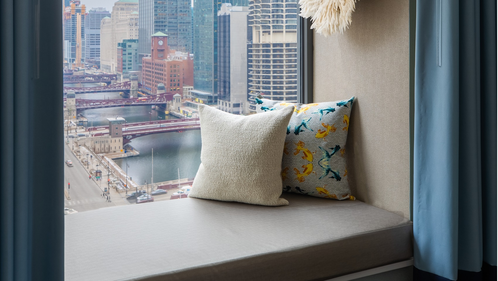 Guestroom window seat with pillows